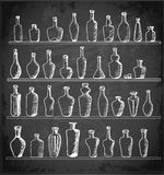 Sketch bottles collection on blackboard. Royalty Free Stock Photos