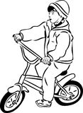 Sketch of a boy riding a bicycle on a small Stock Photos