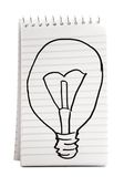 Sketch Of Bulb On Notebook Stock Photos