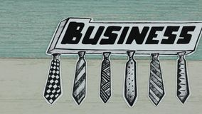 Business and ties. The sketch with the business inscription on wooden back stock footage