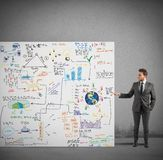 Sketch of a business project. Businessman showing a sketch of a business project Royalty Free Stock Image