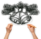 Sketch christmas bells with human hands Royalty Free Stock Photos