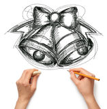 Sketch christmas bells with human hands Royalty Free Stock Photo