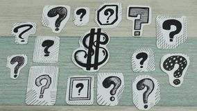 Dollar in questions. The sketch of the dollar sing among question marks stock footage