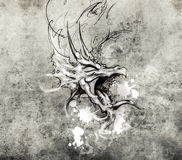 Sketch of a dragon head, tattoo drawing over vintage paper Stock Photography