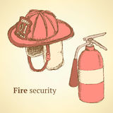 Sketch fire helmet and extinguisher in vintage style.  Royalty Free Stock Photo