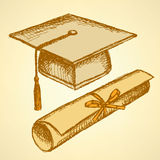 Sketch graduation hat and diploma. Scroll with ribbon Royalty Free Stock Photo