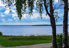 A sketch of the lake on a summer day. Beautiful summer landscape of lake with expressive clouds royalty free stock image