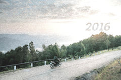 Sketch of man ride motorcycle on mountain and looking for 2016 new year. Royalty Free Stock Images
