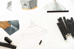 Sketch and markers are on the table. Place for text stock images