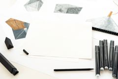 Sketch and markers are on the table. Place for text royalty free stock photo