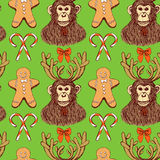 Sketch monkey with reindeer antlers. In vintage style, vector New Year 2016 and Christmas seamless pattern with gingerman and candies Royalty Free Stock Images