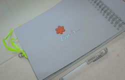 Sketch of an open notepad with the saying `Love is...`,empty space.  Royalty Free Stock Photo