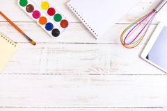 Sketch pad with paints, brush, whisk and tablet Stock Photos