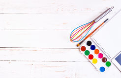 Sketch pad with paints, brush, whisk and tablet Royalty Free Stock Images