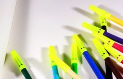 Sketch pens with plain white drawing book. Educational concept close up photo Stock Photos