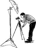 Sketch of a photographer at work Stock Photo