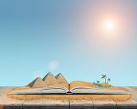 Sketch of the pyramids and oasis in the desert over open book. Royalty Free Stock Photos