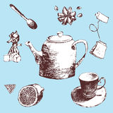 Sketch  set teapot, lemon,cup, tea, sugar, candy and star anise.hand drawn illustration of tea set. Sketch. Stock Photos