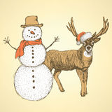 Sketch snowman and raindeer in vintage style Royalty Free Stock Photo