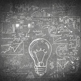Sketch of some ideas. Conceptual sketched image of light bulb and ideas on concrete wall royalty free stock photo