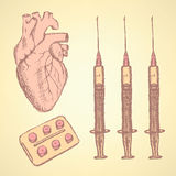 Sketch syringe, pills, human heart Stock Image