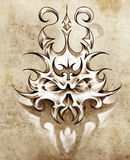 Sketch of tattoo art, skull mask with tribal Stock Photography