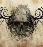 Sketch of tattoo art, skull with tribal flourishes Royalty Free Stock Photo