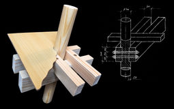 From the sketch to the model. From the sketch to wood model isolated on black background stock photography