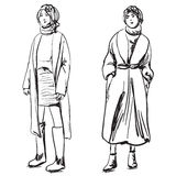 Sketch of woman wearing coat. Winter clothes Royalty Free Stock Photos