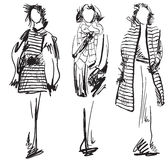 Sketch of woman wearing coat. Winter clothes Royalty Free Stock Photography