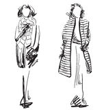 Sketch of woman wearing coat. Winter clothes Royalty Free Stock Images