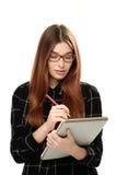 Sketchbook della tenuta della giovane donna Immagini Stock