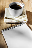 Sketchbook and instant coffee in white cup Royalty Free Stock Photos
