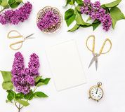 Sketchbook, lilac flowers, office tools Flat lay Stock Photo