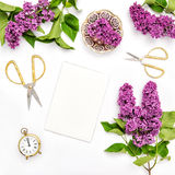 Sketchbook, lilac flowers, office tools golden accessories Stock Photo