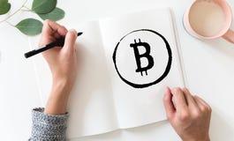 Sketchbook med den Bitcoin logoen royaltyfria foton