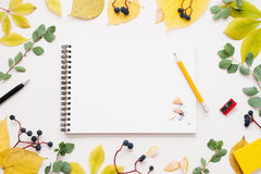Sketchbook with pencil in autumn leaves frame Stock Image