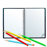 Sketchbook with pencils. Open sketchbook with colorful pencils isolated on white Royalty Free Stock Images