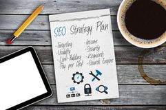 Sketchbook with SEO Strategy plan on a desktop stock photography