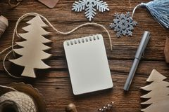Sketchbook on wooden table in Christmas theme royalty free stock photo