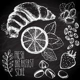 Sketched breakfast seamless background with croissant, lemon and berries. Drawned on black board with chalk. Stock Images