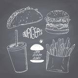Sketched chalk style fast food set with burger. Sketched fast food set with burger, french fries, taco and paper cup of milk shake. Design for cafe, restaurants Royalty Free Stock Photos
