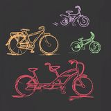 Sketched chalky bicycle set on blackboard Royalty Free Stock Photography