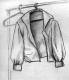 Sketched hanging jacket. Hand drawn pencil sketch of a jacket hanging on a clothes hanger Royalty Free Stock Photo