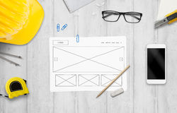 Sketched idea od website on designer desk. Top view with construction tools stock images
