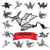 Sketched origami dragons Royalty Free Stock Photos