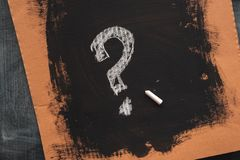 Sketched question mark on cardboard paper royalty free stock photography
