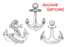 Sketches of ancient marine anchors with rope Royalty Free Stock Photo