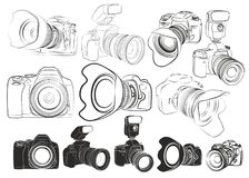 Sketches of cameras. The Sketches of professional cameras with flashes Royalty Free Stock Photography